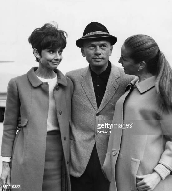 From left to right actress Audrey Hepburn actor Yul Brynner and his wife Doris in Geneva Switzerland 12th April 1965 Hepburn is there to house hunt