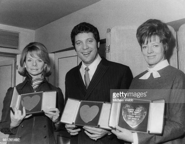 From left to right actress Jill Bennett singer Tom Jones and actress Maggie Smith with their awards at the Variety Club of Great Britain Show...
