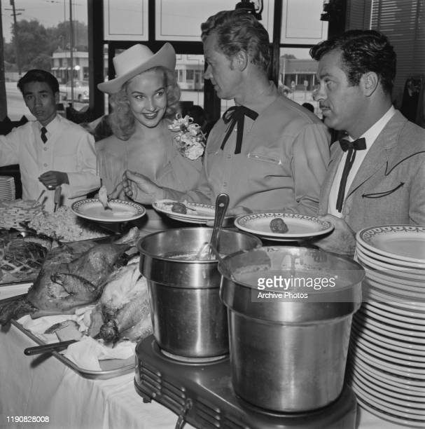 From left to right actress Kathy Marlowe actor Bill Williams and actor Don Diamond at a party for tailor Nudie Cohn and various Western stars USA...