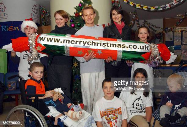 From left to right Actress Keeley Hawes actor Adam Rickitt and TV presenter Melanie Sykes with patients during the launch of the ECard Christmas...