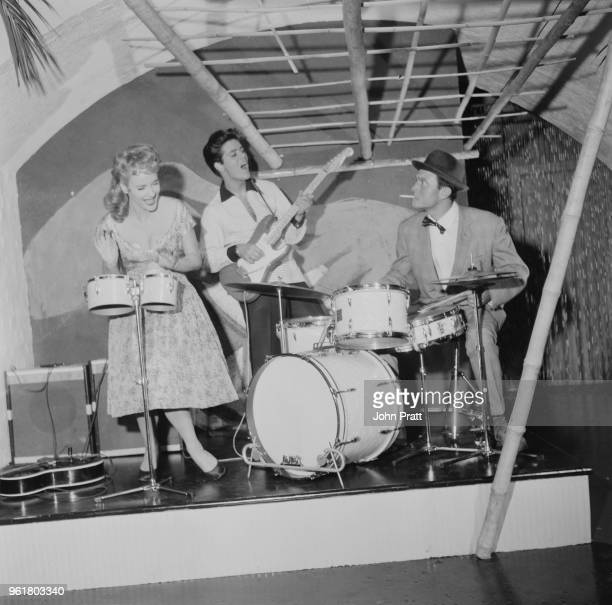 From left to right, actress Sylvia Syms, singer Cliff Richard and actor Laurence Harvey filming 'Expresso Bongo' at Shepperton Studios, UK, August...