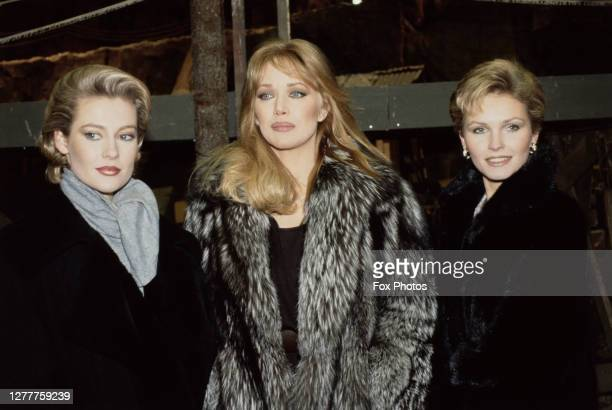 From left to right, actresses Alison Doody, Tanya Roberts and Fiona Fullerton pose at Pinewood Studios in England, to promote the new James Bond film...