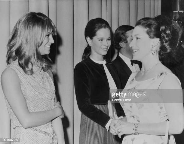 From left to right actresses Julie Christie and Geraldine Chaplin meet Princess Margaret at the Empire Leicester Square in London before the gala...
