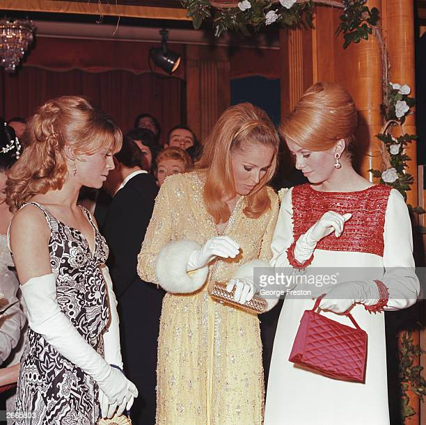From left to right actresses Julie Christie Ursula Andress and Catherine Deneuve attend a Royal Film Performance of 'Born Free' at the Odeon...