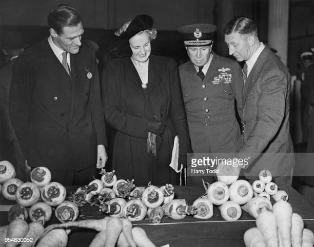 From left to right Aidan Merivale Crawley the UnderSecretary of State for Air Lady Slessor and Air Chief Marshal Sir Hugh Pughe Lloyd Air Officer...