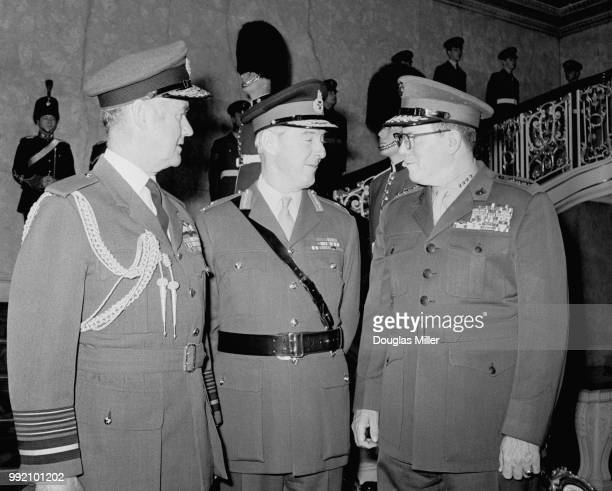 From left to right Air Chief Marshal Sir Christopher FoxleyNorris of the RAF General John Gibbon of the British Army and General Robert E Cushman Jr...