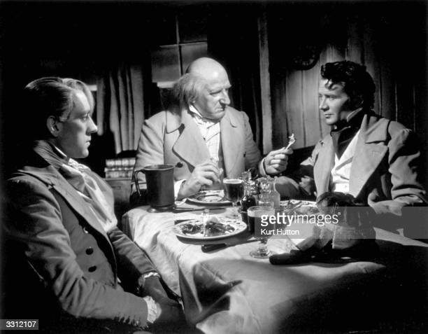 From left to right Alec Guinness Finlay Currie and John Mills star in the Cineguild film adaptation of Dickens' classic novel 'Great Expectations'...