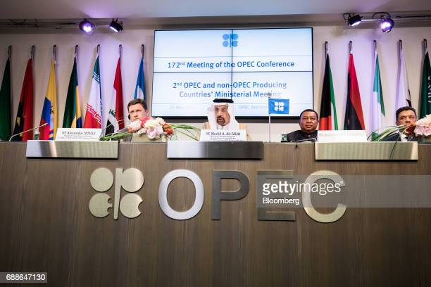 From left to right Alexander Novak Russia's energy minister Khalid Bin Abdulaziz AlFalih Saudi Arabia's energy minister and president of OPEC...