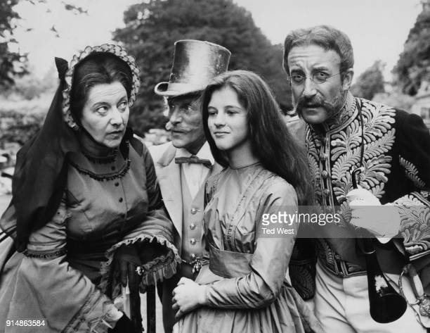 From left to right Alison Leggatt Wilfrid Brambell AnneMarie Mallik and Peter Sellers during the filming of a BBC production of Lewis Carroll's...