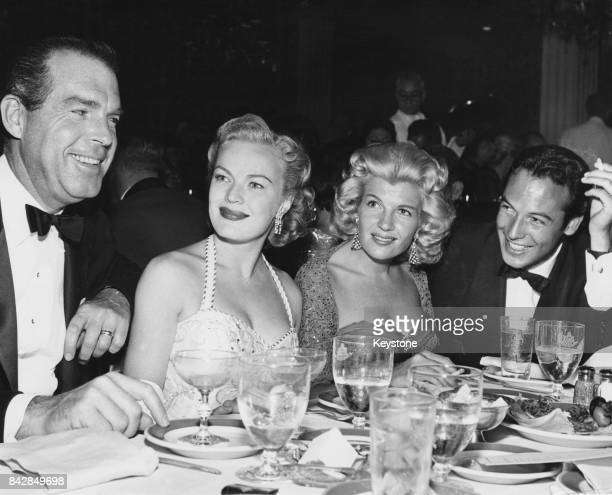 From left to right American actor Fred MacMurray his wife actress June Haver actress Corinne Calvet and her husband actor Jeffrey Stone out on the...