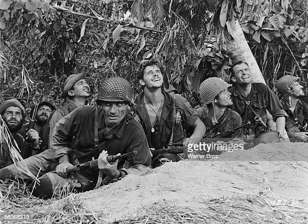 From left to right American actor Jeff Chandler as Brigadier General Frank D Merrill Peter Brown as Bullseye Ty Hardin as Stockton and Chuck Hayward...