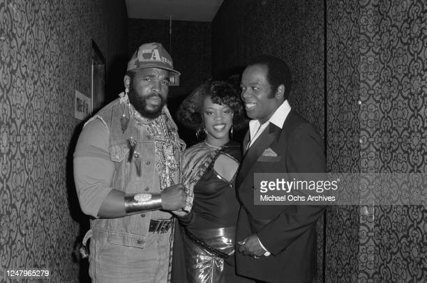 From left to right, American actor Mr T with singers Evelyn 'Champagne' King and Lou Rawls during the 1985 Black Gold Awards in Los Angeles, 1985. Mr...