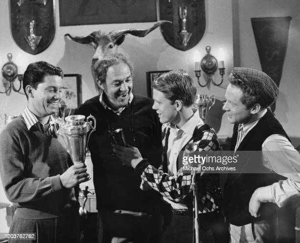 From left to right, American actors Anson Williams, Jerry Paris, Ron Howard and Donny Most in a scene from the television sitcom 'Happy Days', circa...