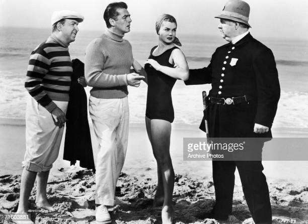 From left to right American actors Jesse White Victor Mature Esther Williams and Charles Watts star in the MGM film 'Million Dollar Mermaid' a biopic...