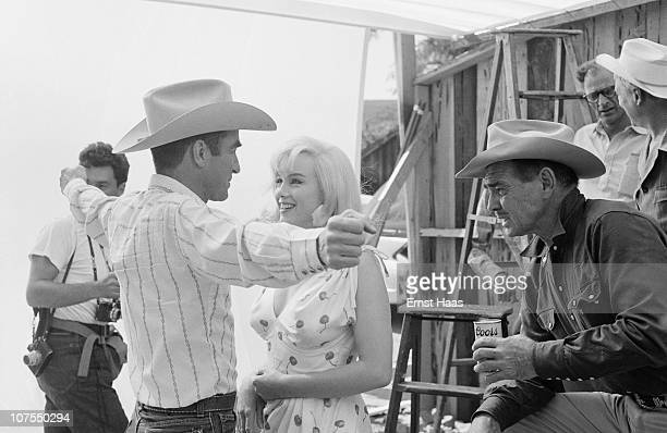 From left to right American actors Montgomery Clift Marilyn Monroe and Clark Gable during the location shoot of 'The Misfits' in the Nevada Desert...