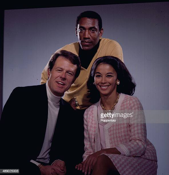 American actors Robert Culp Bill Cosby and French actress France Nuyen posed on the set of the television series 'I Spy' in 1967