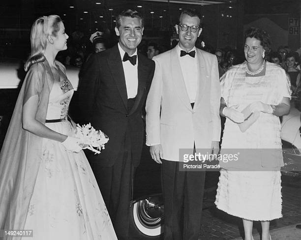From left to right American actress Grace Kelly and actor Cary Grant with George M Leader Governor of Pennsylvania and his wife Mary at a Drake Hotel...