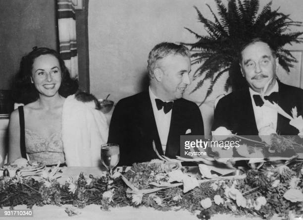 From left to right American actress Paulette Goddard English actor and filmmaker Charlie Chaplin and writer H G Wells at a dinner at the Hollywood...