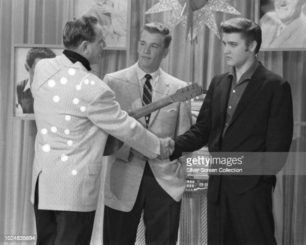 From left to right American disc jockey Dewey Phillips television presenter Wink Martindale and singer Elvis Presley on Wink's television show...