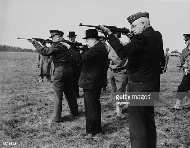 From left to right American General Dwight D Eisenhower British Prime Minister Winston Churchill and LtGen Omar Bradley shooting with the American...