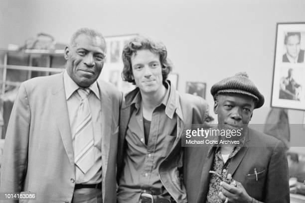 From left to right American musicians Howlin' Wolf born Chester Arthur Burnett John Hammond Jr and John Lee Hooker circa 1965