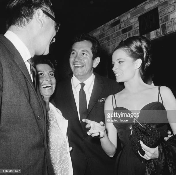 From left to right American producer Ross Hunter and his date singer Nancy Sinatra American singer guitarist and actor Trini Lopez and his date...