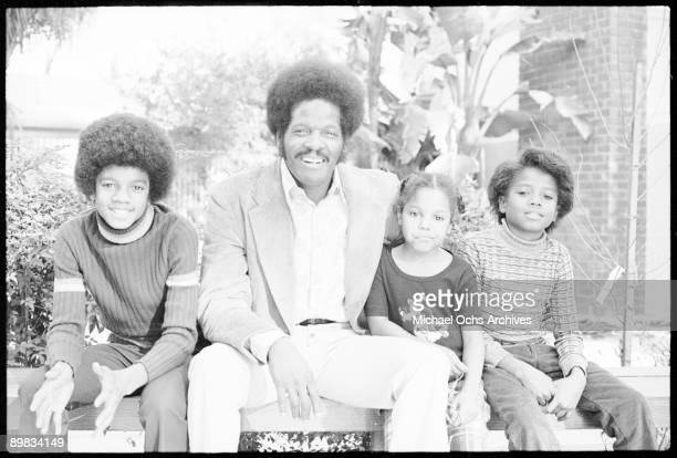 From left to right American singer Michael Jackson an unknown man and singers Janet and Randy Jackson at the Jacksons' home in Los Angeles 18th...