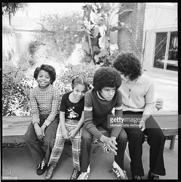 From left to right American singers Randy Janet and Michael Jackson the youngest members of the Jackson family at home in Los Angeles with a...