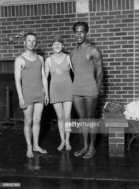From left to right American swimming champions Ludy Langer Claire Galligan and Duke Kahanamoku circa 1920