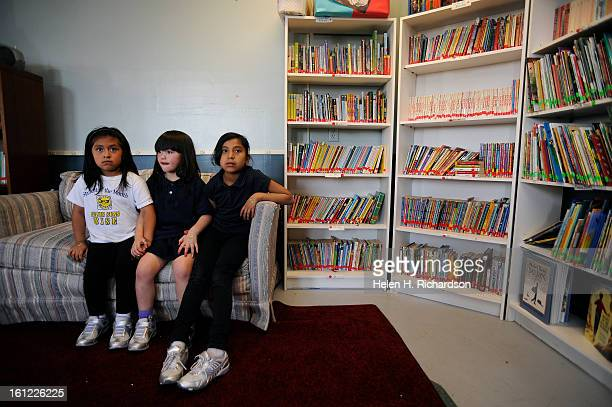 From left to right Amy Hernandez Shavonnah Paiz 6 and Evelyn Samperio hold hands during the beginning of their afterschool program as education...