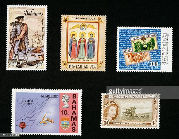 From left to right and from top to bottom postage stamp from the Pirates series depicting Woodes Rogers Christmas postage stamp depicting the Three...