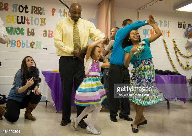 MARCH 16 from left to right Andre Morman and his daughter Jhaniyika Morman 6 along with Eric Prince and his daughter Kayla Lewis 11 salsa dance with...