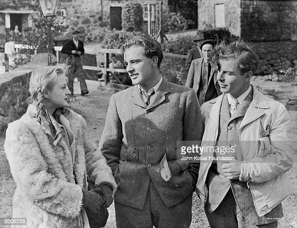 From left to right Andrea Lea Richard Burton and Emlyn Williams star in 'The Last Days of Dolwyn' directed by Williams for London Film Productions