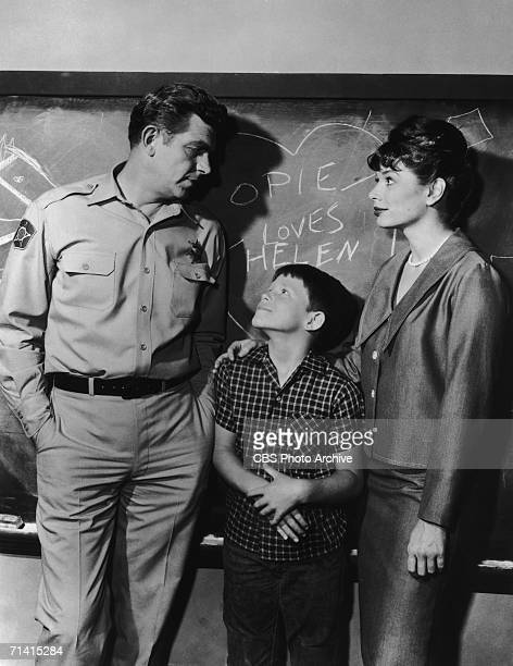 From left to right Andy Griffith as Sheriff Andy Taylor Ron Howard as his son Opie Taylor and Aneta Corsaut as Helen Crump in a scene from the...