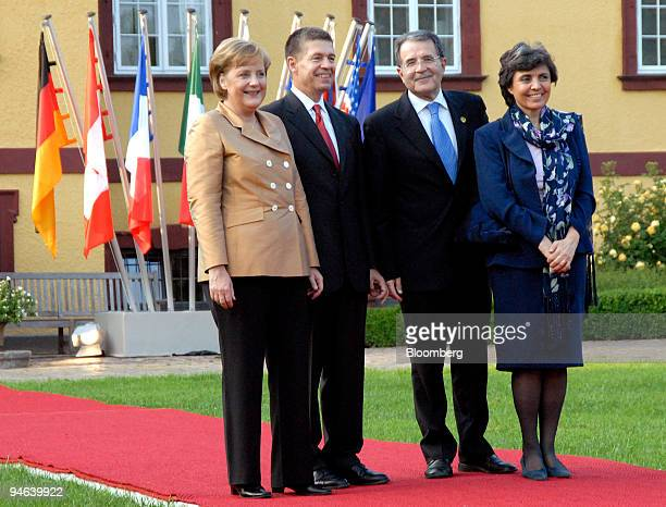 From left to right Angela Merkel chancellor of Germany and her husband Joachim Sauer welcome Romano Prodi prime minister of Italy and his wife Flavia...