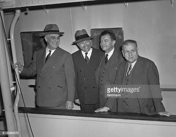 From left to right are US President Franklin D. Roosevelt, Rear Admiral Ross T. McIntyre, Attorney General Robert H. Jackson, and Secretary of the...
