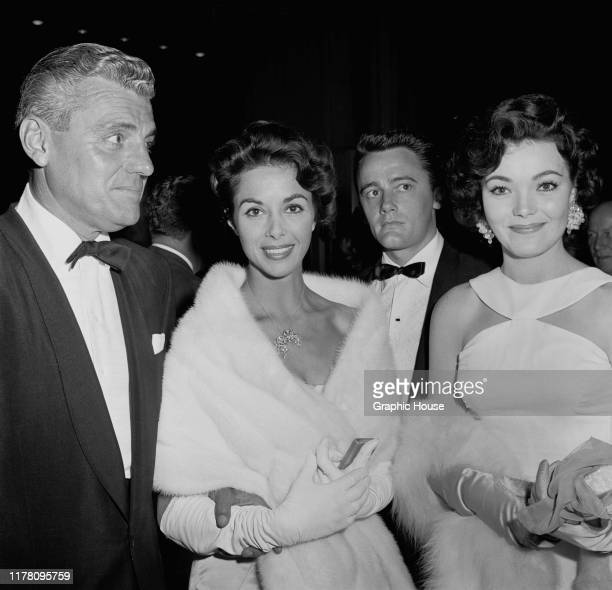 From left to right attorney Greg Bautzer with his wife English actress Dana Wynter actor Robert Vaughn and actress Kipp Hamilton at the premiere of...