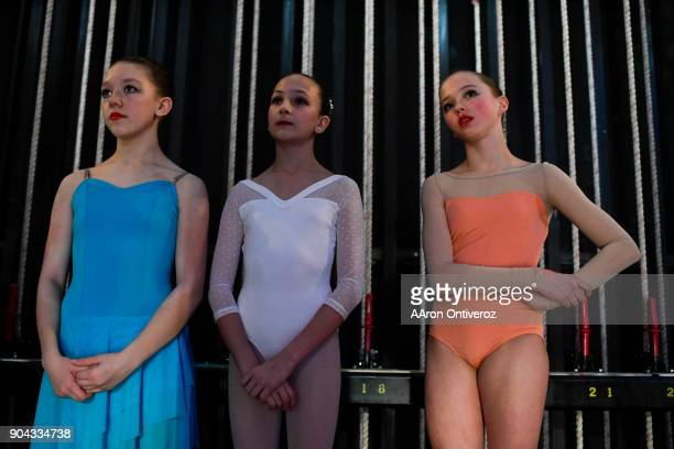 From left to right Audrey Gomes Lauren Woodward and Lydia Foley watch from the side of the stage as another performer dances during the 2018 Youth...