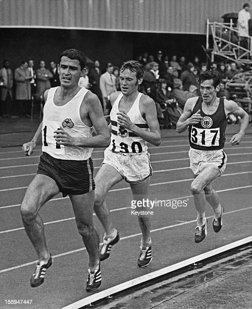 From left to right, Australian athlete Ron Clarke leads Dick Taylor of England and Lachie Stewart of Scotland during the 10,000 Metres at the British...