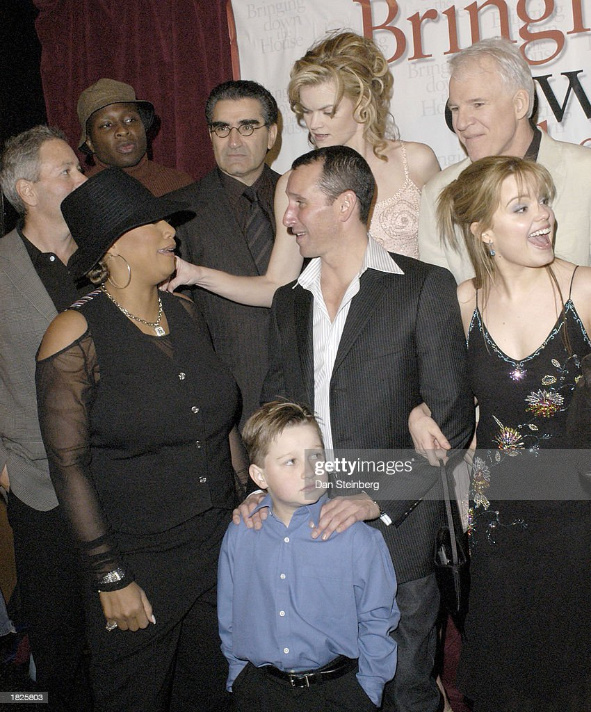 From left to right, back row, Producer David Hoberman, Actor Steve Harris, Actor Eugene Levy, Actress Missi Pyle, Actor Steve Martin, front row, Actress Queen Latifah, Actor Angus T. Jones, Director Adam Shankman, Actress Kimberly J. Brown at the premiere of their movie 'Bringing Down The House' on March 2, 2003 in Los Angeles, California.