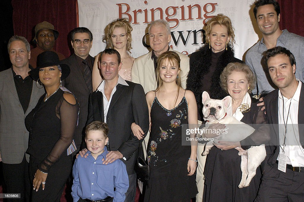 From left to right, back row, Producer David Hoberman, Actor Steve Harris, Actor Eugene Levy, Actress Missi Pyle, Actor Steve Martin, Actress Jean Smart, Actor Victor Webster, front row, Actress Queen Latifah, Actor Angus T. Jones, Director Adam Shankman, Actress Kimberly J. Brown, Animal Actor Linus, Actress Betty White, and Co-Producer Todd Lieberman at the premiere of their movie 'Bringing Down The House' on March 2, 2003 in Los Angeles, California.