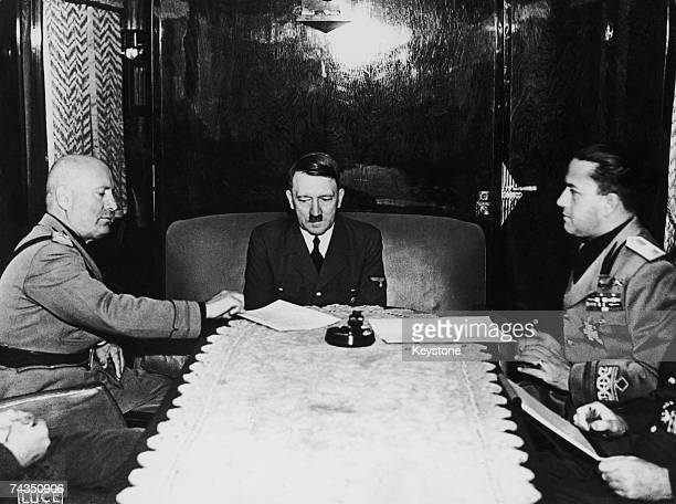 From left to right, Benito Mussolini , Adolf Hitler and Italian Foreign Minister Count Galeazzo Ciano meet at the Brenner Pass during World War II,...