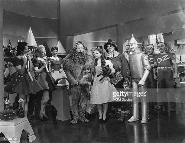 From left to right Bert Lahr as the Cowardly Lion Judy Garland as Dorothy Ray Bolger as the Scarecrow and Jack Haley as the Tin Man in the MGM film...
