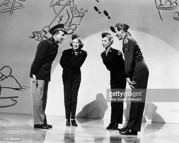 From left to right Bing Crosby as Bob Wallace Rosemary Clooney as Betty Haynes VeraEllen as Judy Haynes and Danny Kaye as Phil Davis in the musical...