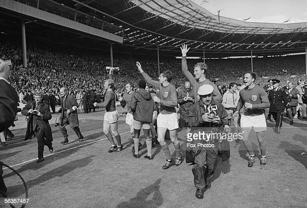 From left to right Bobby Moore Alan Ball George Cohen Jack Charlton and Martin Peters do a lap of honour at Wembley after beating West Germany 42 in...