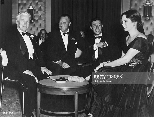 From left to right British actor and director Charles Chaplin American newspaper columnist Harry Crocker and American songwriter Adolf Green all in...