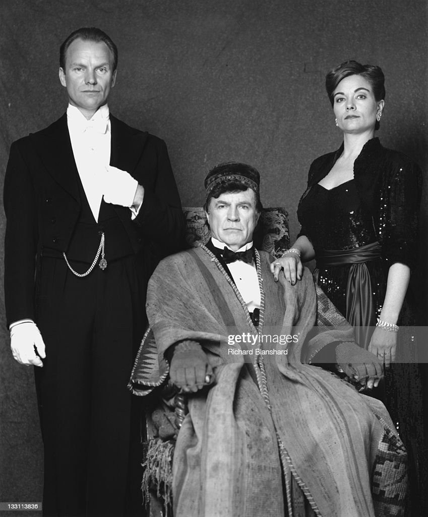 From left to right, British actor and singer Sting as the butler Fledge, Alan Bates (1934 - 2003) as his master, Sir Hugo Coal, and American actress Theresa Russell as Lady Harriet Coal in the film 'The Grotesque', 1995.