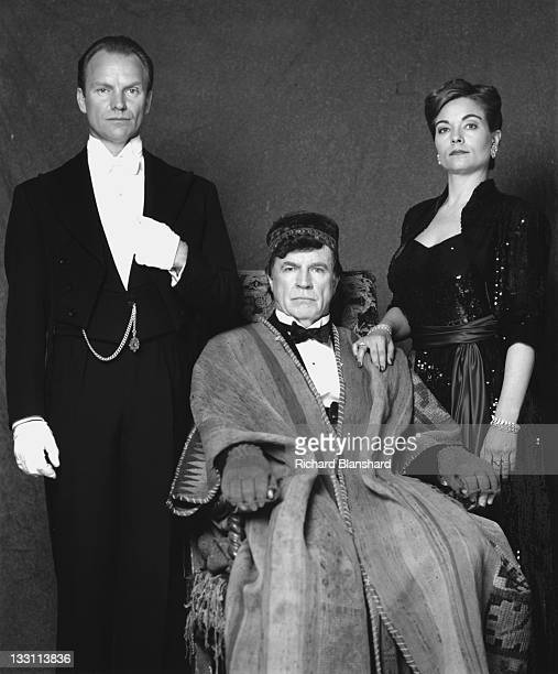 From left to right British actor and singer Sting as the butler Fledge Alan Bates as his master Sir Hugo Coal and American actress Theresa Russell as...