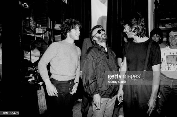 From left to right British actor Paul McGann musician Ringo Starr and screenwriter and director Bruce Robinson on the set of the movie 'Withnail I'...