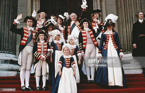 From left to right British actors Julian RhindTutt Helen Mirren Nigel Hawthorne Rupert Everett and Julian Wadham with the royal children in a scene...